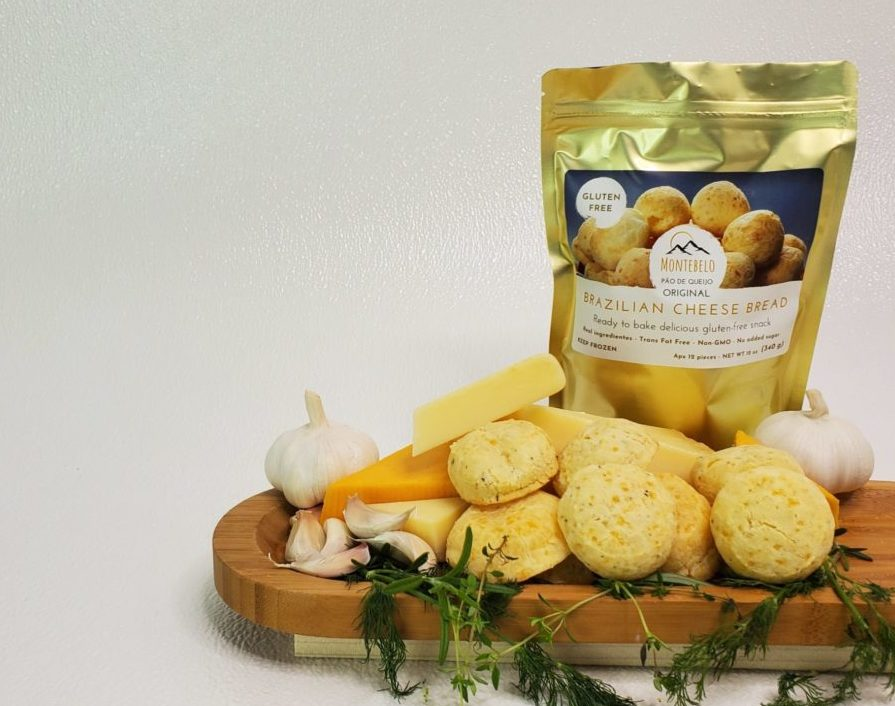 Montebelo Brazilian Cheese Bread With table full of baked cheese bread and spices